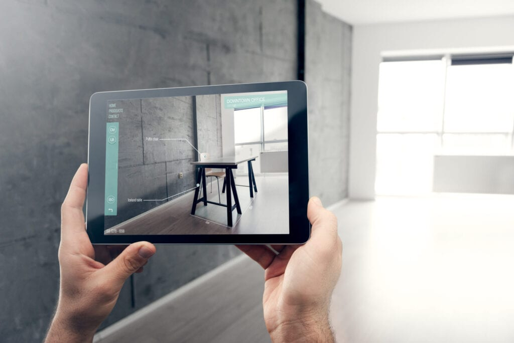 Person using augmented reality on tablet to design their home