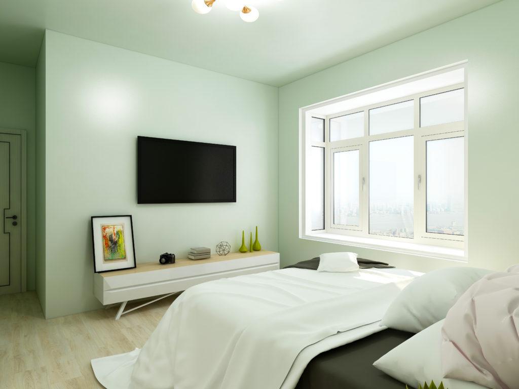 Light green bedroom facing television