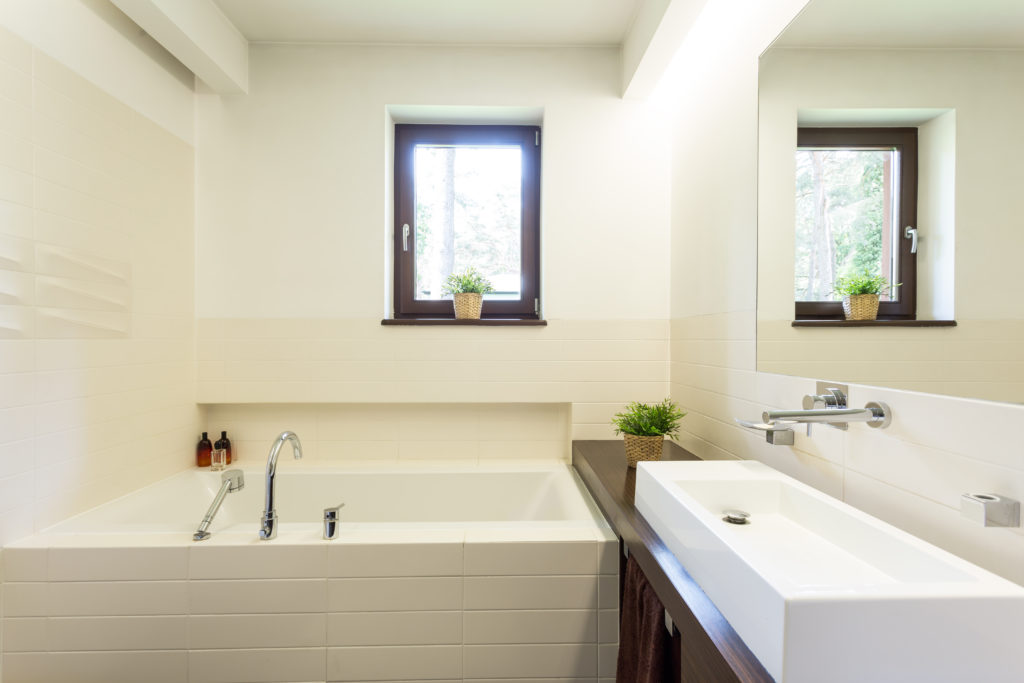 Off-white bathroom with sunny window