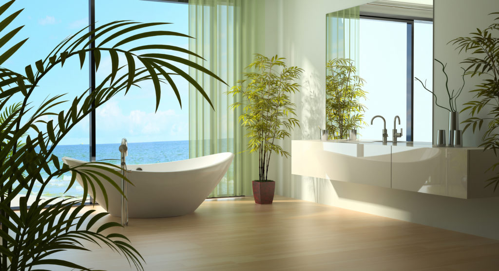 Green bathroom with floor to ceiling windows and green plants