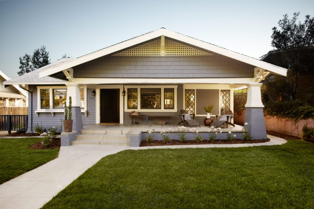Blue-gray craftsman style house with green grass lawn