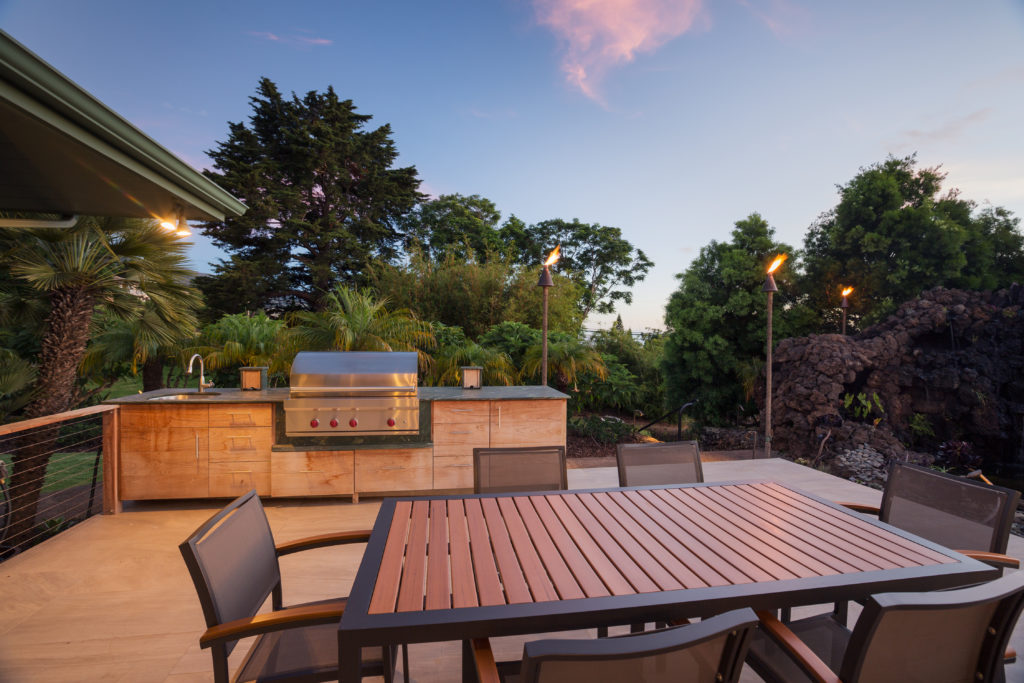 Outdoor dining area on wooden deck at sunset