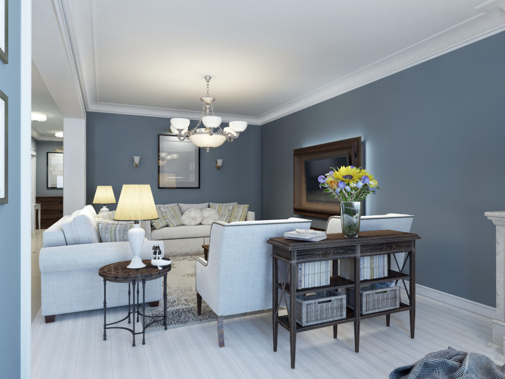 Living room with white couch and classic blue walls