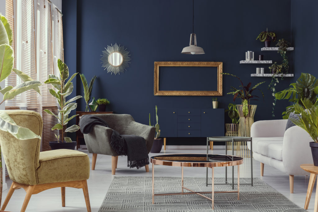 Living room with navy blue walls and copper decor
