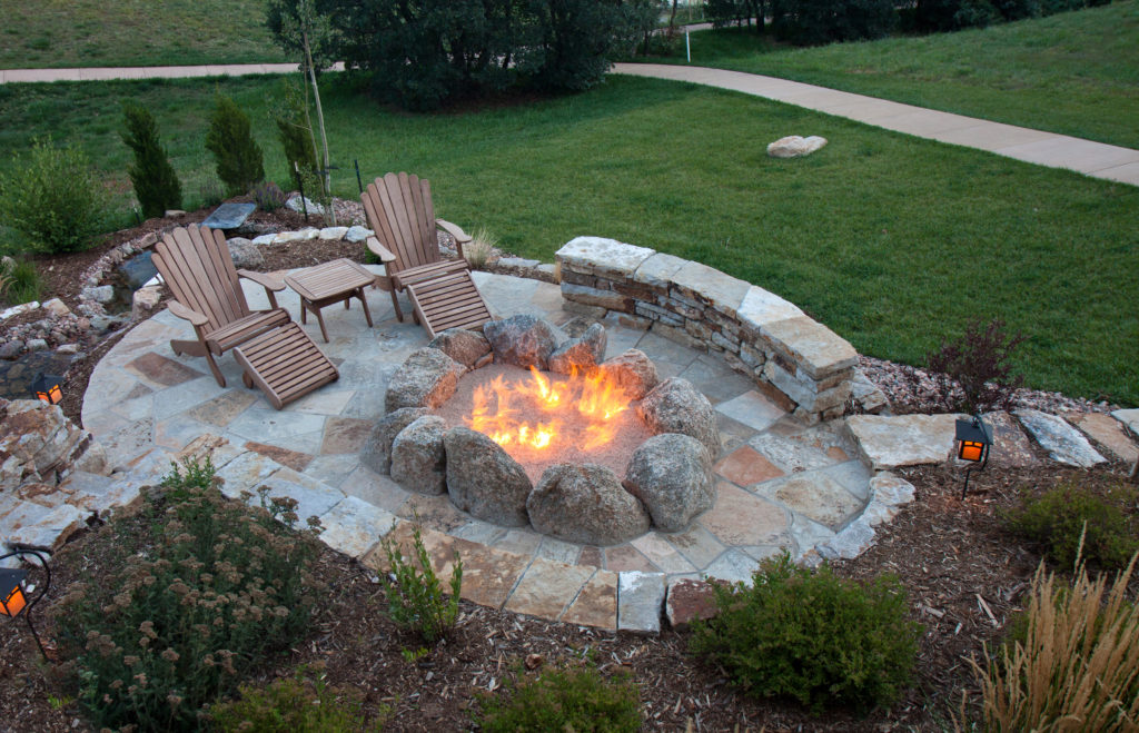 In ground stone fire pit with walkway