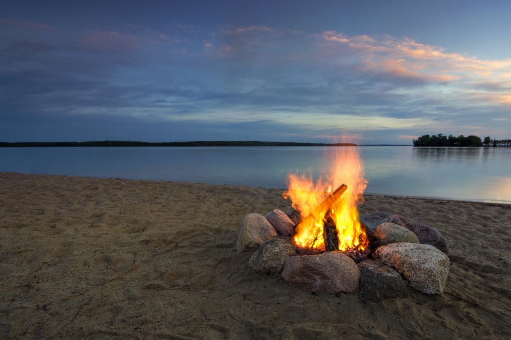 Stone fire pit on lake in Minnesota