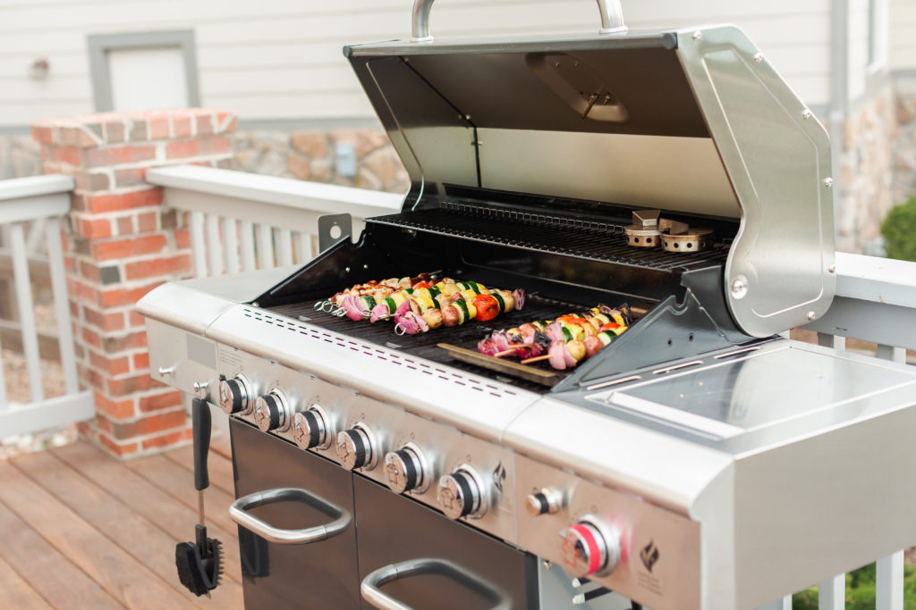 Outdoor grill with vegetables cooking