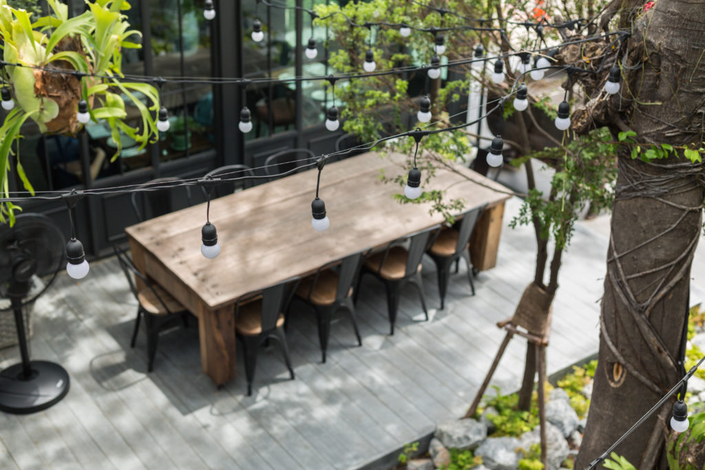 Bird's eye view of backyard dining table with lights