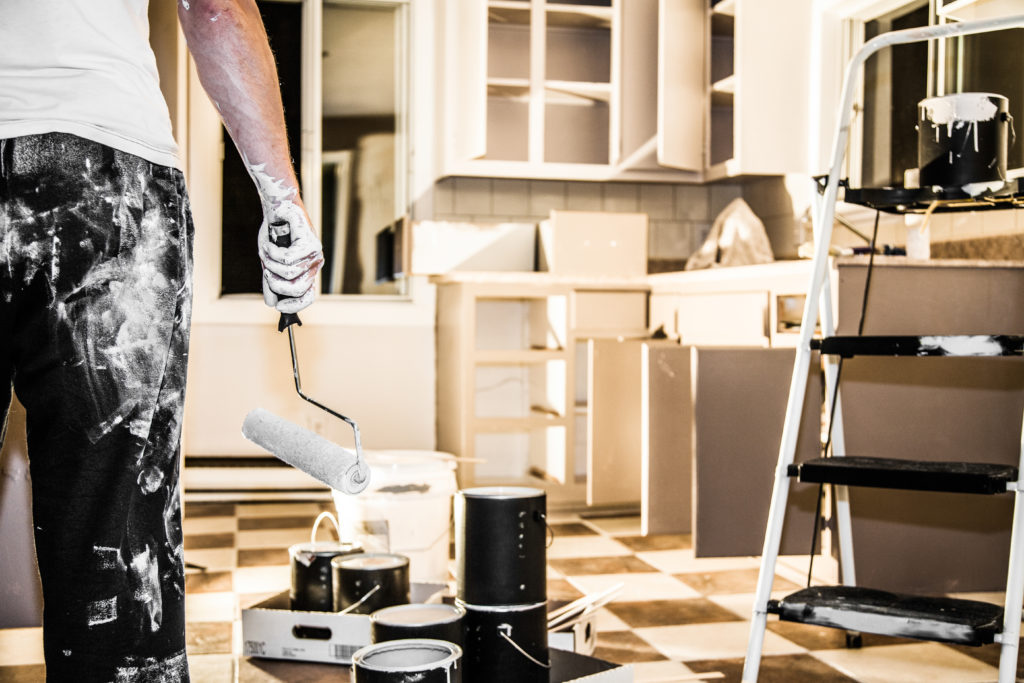 Man paints his kitchen cabinets white