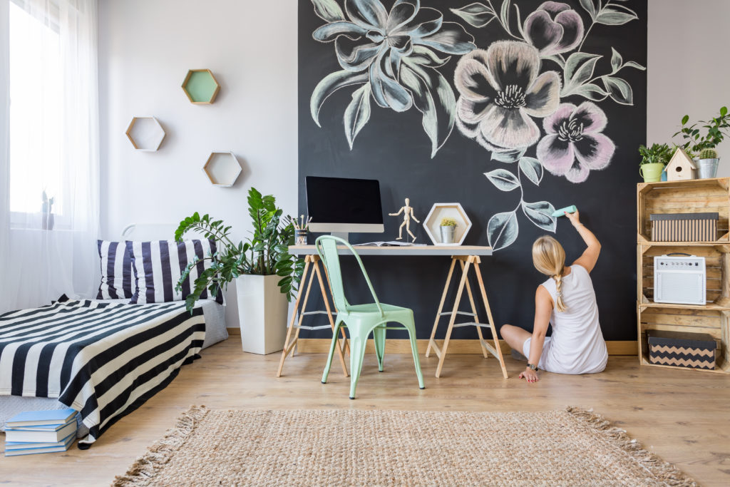 Woman decorating an accent wall
