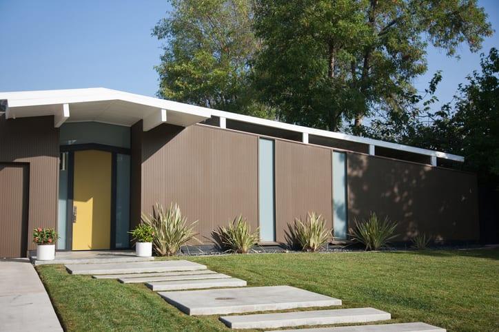 Exterior of modern home with mustard front door