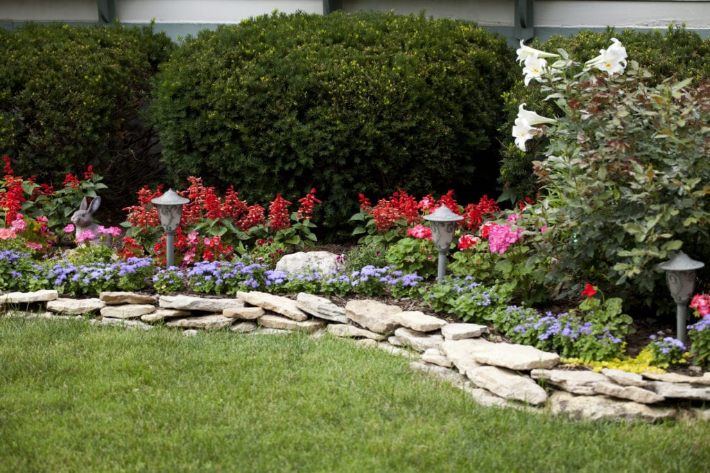 flower garden with stacked rock edging