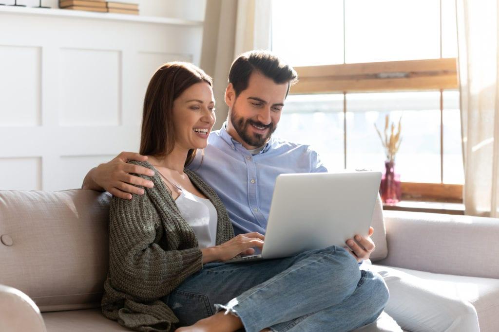 happy couple on laptop