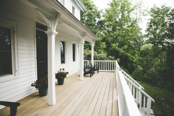 Exterior shot of front porch at old farmhouse