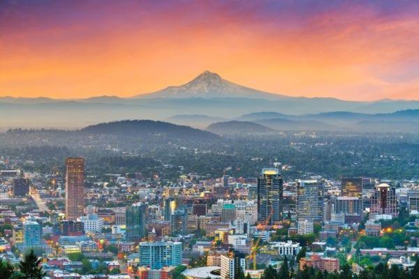 Mt Hood behind Portland skyline at dawn