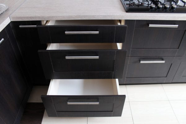 Black kitchen cabinets with open drawers