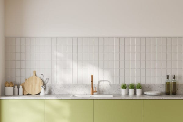 Close up of green countertops with built in sink