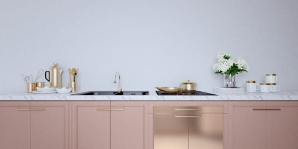 Rose gold kitchen cabinets with accent metallic cabinet