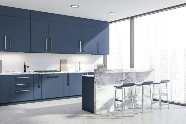 Corner of modern kitchen with white walls, concrete floor, panoramic windows, and navy cabinets