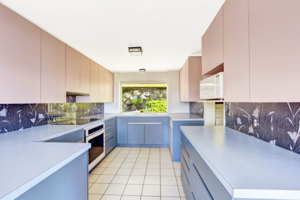 Antique kitchen with blue and pale pink cabinets