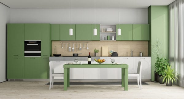 Green and white modern kitchen with dining table