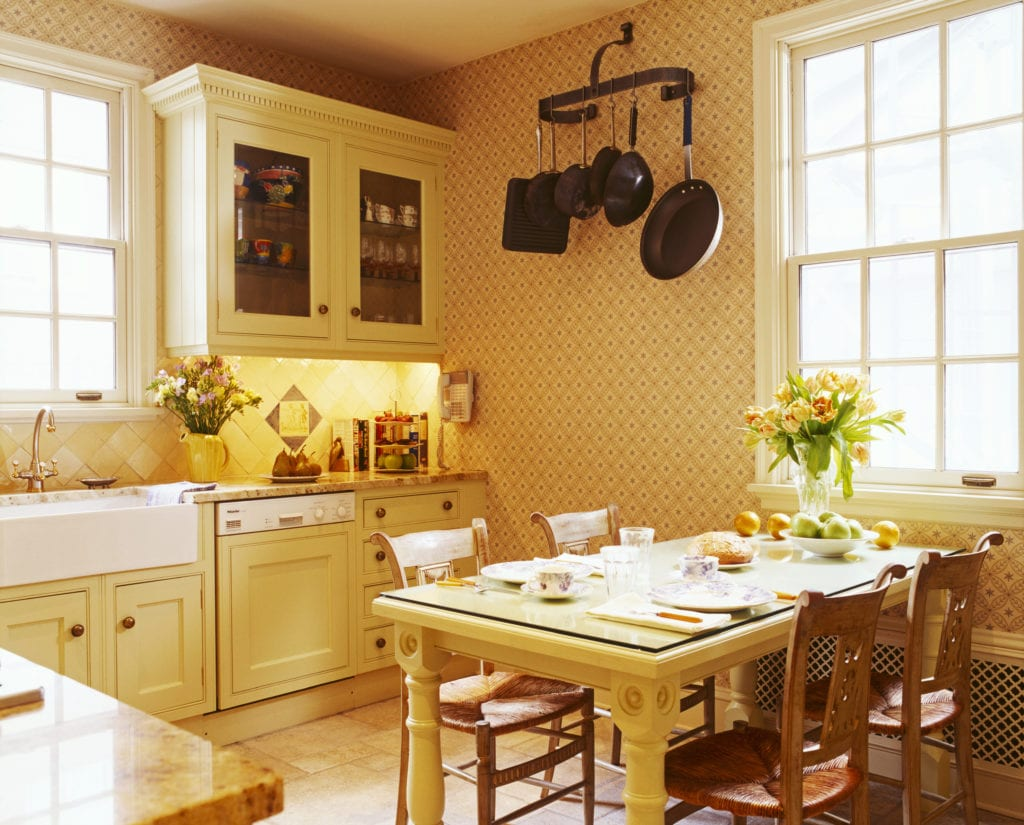 Traditional Country Kitchen with Cane Seat Chairs at Table