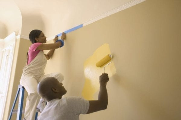 Couple Painting Wall Yellow