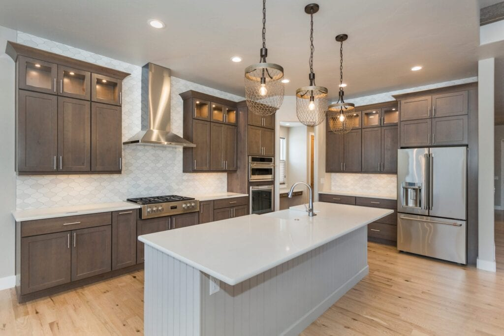kitchen interior, taupe cabinets and white island