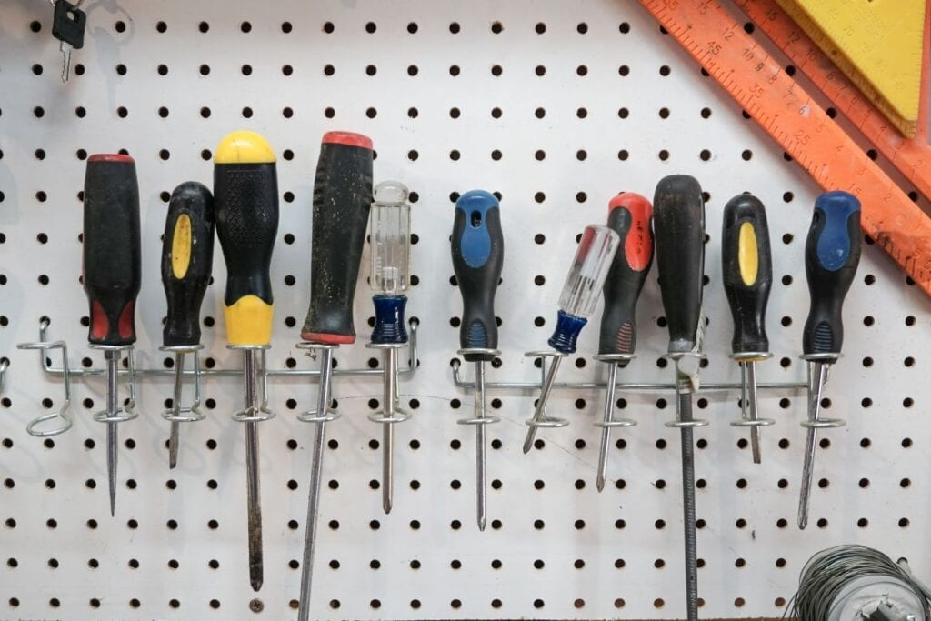 Screwdrivers arranged on pegboard to keep garage organized