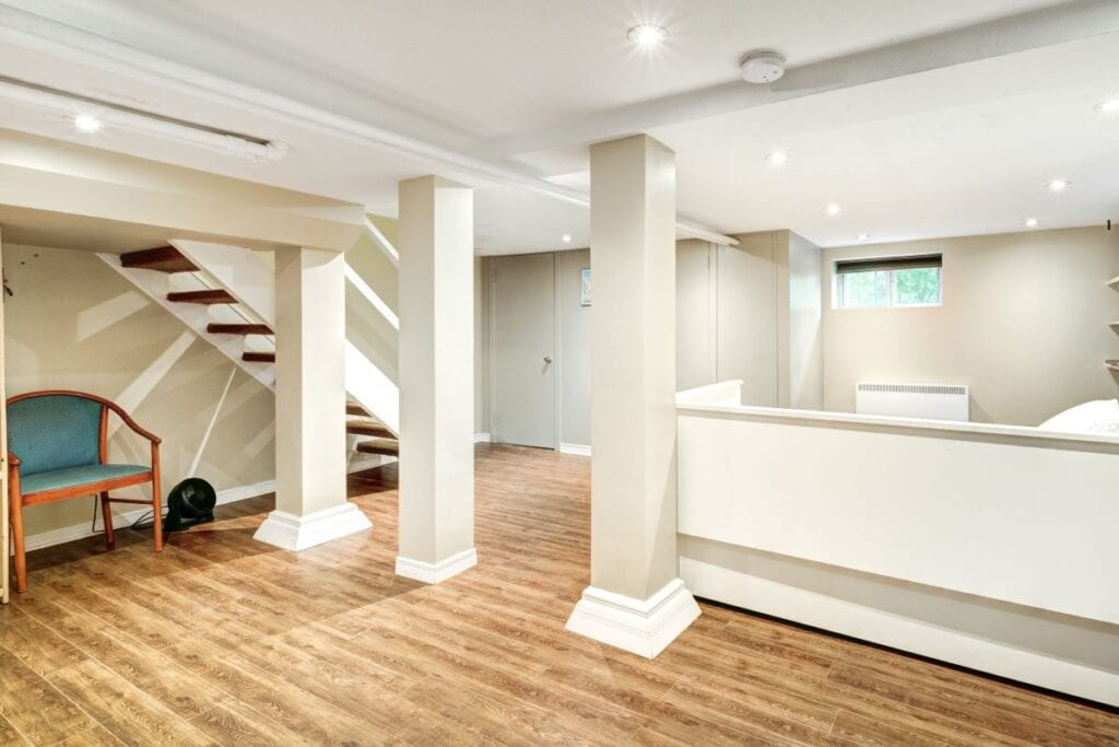 Finished basement with grey beige paint