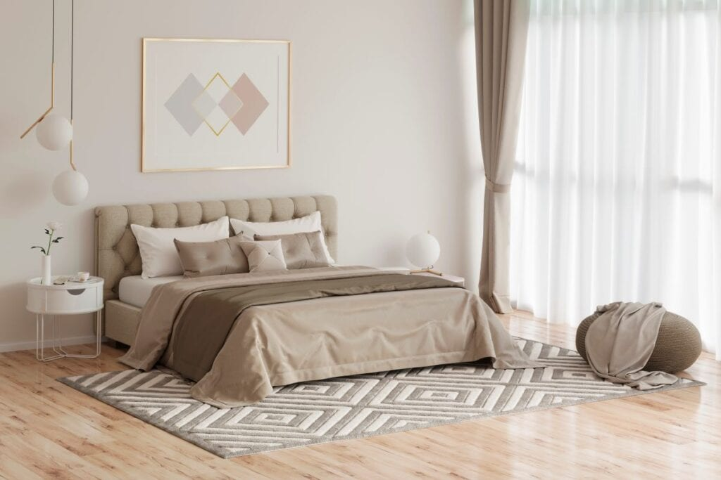 Greige, tan, and brown colored bedroom for guests