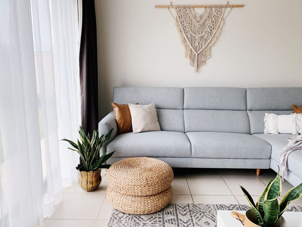 Modern boho chic living room with gray couch and greige wall paint