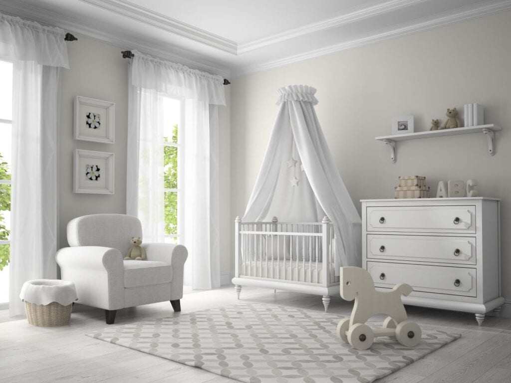 Neutral colored nursery with white furniture and greige walls