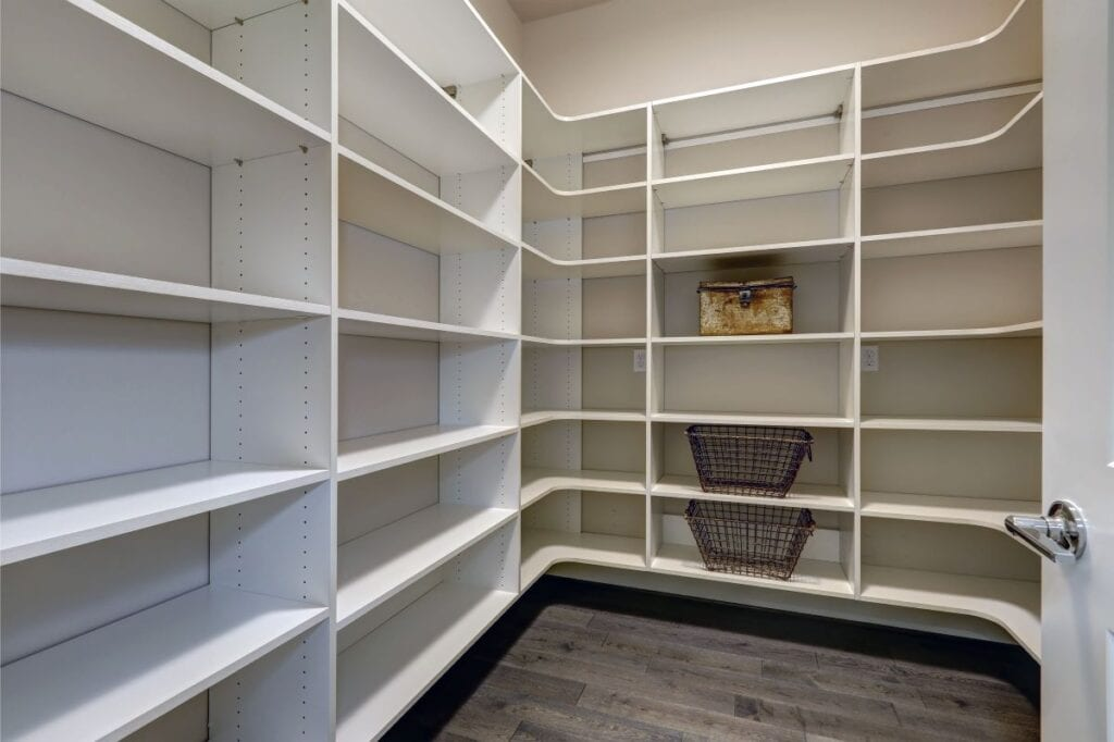 Pantry room with lots of shelves and greige wall paint