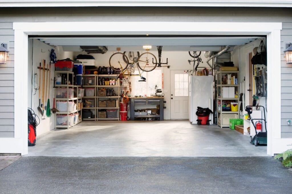 Organized garage with a lot of storage, bikes stored overhead