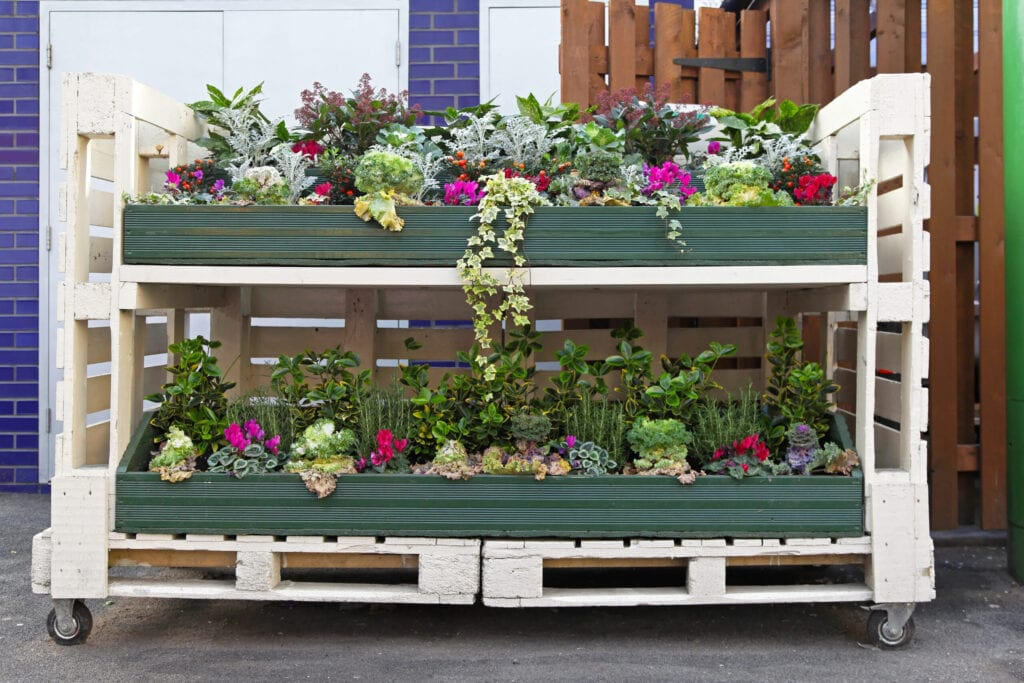 Shipping pallets used for storage, garden built on shipping pallets